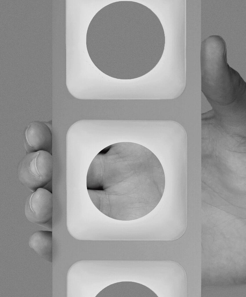 closeup of hand holding aperture circle light